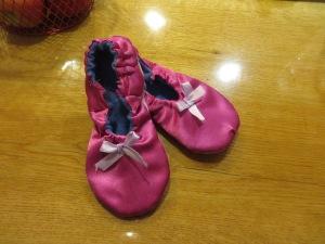 Pink costume satin w/ encased elastic closure and ribbon embellishment.