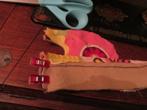 Sewing heel band piece to upper slipper sole.