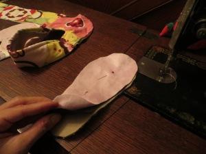 Pretty side suede cloth, canvas sole piece, and, finally, fleece inner piece.