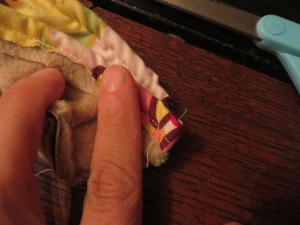 Puckering the seams at a diagonal to give the slipper a shape that sits closer to the foot.