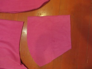 Upper body portion of cape cut, folded in half.
