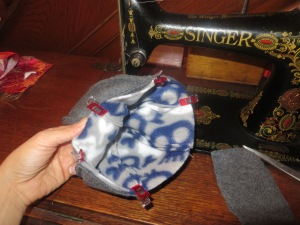 Hats inside one another, right sides together and clipped for sewing.